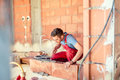 Stonemason building walls, construction engineer and worker on site Royalty Free Stock Photo