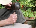 Stonemason engraving a with a hammer and chisel Stock Photos