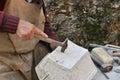 Stonemason hands detail of craftsman at work Stock Photo
