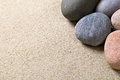 Stones background pebble on sandy beach sandy texture macro shot Royalty Free Stock Photos