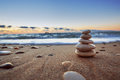 Stones balance on beach sunrise shot Royalty Free Stock Photography
