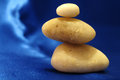 Stones in balance white over blue background zen concept Royalty Free Stock Image