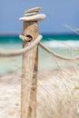 Stones balanced on wooden banister near the trucadors beach formentera island spain Stock Photo
