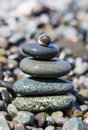 Stones balancing wet on the beach Stock Photo