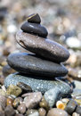 Stones balancing wet on the beach Royalty Free Stock Image