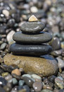 Stones balancing wet on the beach Royalty Free Stock Photos