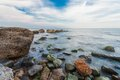 Stones on beach sea and blue sky crimea ukraine Stock Photography