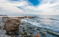 Stones on beach sea and blue sky crimea ukraine Royalty Free Stock Images