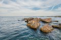 Stones on beach sea and blue sky crimea ukraine Royalty Free Stock Image