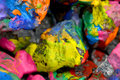 Stones with colorful paint abstract background colored randomly in different colors Stock Image