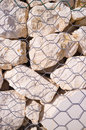 Stones of a gabion wall detail take behind the mesh Royalty Free Stock Photo