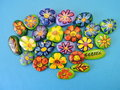 Stones with painted flowers and leaves Royalty Free Stock Photo