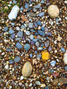 Stones and pebbles abstract background image of on the ground creating a great texture for designers Royalty Free Stock Image