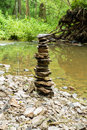 Stones pyramid near small river symbolizing zen harmony balance Royalty Free Stock Photos