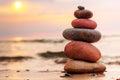 Stones pyramid on sand symbolizing harmony