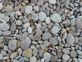 Stones or rounded pebbles on a beach Royalty Free Stock Photos