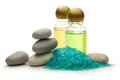 Stones sea salt and shampoo bottles Royalty Free Stock Photo