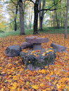 Stones table and chair autumn in park Stock Photography