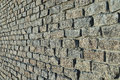 Stones wall from granite bricks Royalty Free Stock Photo