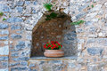 Stonewall niche with flowerpot a in a a Royalty Free Stock Photo