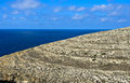 Stony landscape by the sea mediterranean in south of island of malta Royalty Free Stock Photos