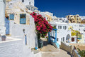 Stony road to Thira town among churches and traditional houses on Santorini island, Greece Royalty Free Stock Photo
