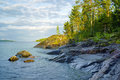 Stony shore of ladoga lake at the end summer day karelia russia Royalty Free Stock Image