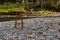 Stool on a riverbed in the morning sun Royalty Free Stock Photography