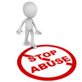 Stop abuse word being stepped upon by a little man on white background Stock Photo