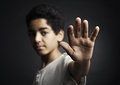 Stop african teenager holds hand out as sign Royalty Free Stock Photography