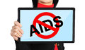 Stop aids concept holding tablet with symbol Stock Photo