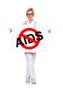 Stop aids female doctor holding poster with Royalty Free Stock Photo
