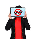 Stop aids holding tablet with symbol Royalty Free Stock Photo