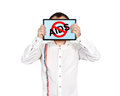 Stop aids symbol businessman holding tablet with Stock Photography