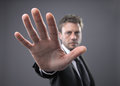 Stop businessman in a suit gesturing Stock Image