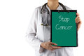Stop Cancer - Female doctor's hand holding medical clipboard and stethoscope. Concept of Healthcare And Medicine. Copy Royalty Free Stock Photo