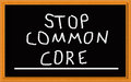 Stop common core on chalkboard written black Stock Images