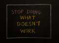 Stop doing what does t work message on black background and concept design Stock Images