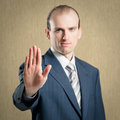 Stop gesture businessman making focus on the palm Royalty Free Stock Images