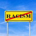 Stop racism word written on yellow read sign and crossed off Stock Photography