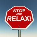 Stop and relax concept take it easy with this road sign over a clean blue sky Royalty Free Stock Photos