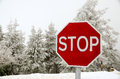 Stop road sign snowy day winter Royalty Free Stock Photos