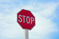 Stop sign blue sky background with the Stock Photos