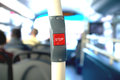 Stop sign in a bus button upper deck of london with some people sitting Royalty Free Stock Photo