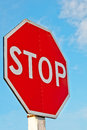 Stop sign with a cloudy sky Stock Photography