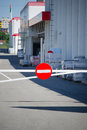 Stop sign before entering the warehouse Stock Image