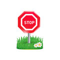 Stop sign and grass isolated on white background Royalty Free Stock Photos