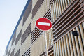 Stop sign near new parking building, empty street nobody concept Royalty Free Stock Photo