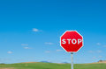 Stop sign over blue sky background Stock Images
