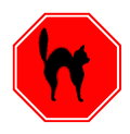Stop sign red with unlucky black cat halloween and misfortune motif Royalty Free Stock Images